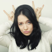 Funny woman doing hand sign — Stock Photo