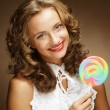 Young woman with colorful lollipop — Stock Photo #69443793