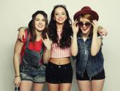 Three stylish sexy hipster girls best friends. — Stockfoto