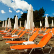 Sunchairs with  umbrellas on beautiful  beach — Stock Photo #69574211