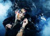 Beautiful woman with artistic make-up — Stock Photo