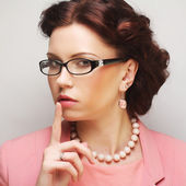 Young businesswoman in pink wearing glasses. — Стоковое фото