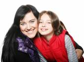 Mother and her daughter smiling at the camera — Stock Photo
