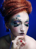 Woman with artistic make-up — Stock Photo