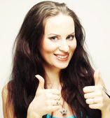 Happy woman showing thumbs up — Stock Photo