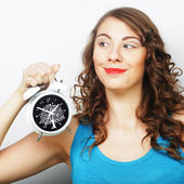 Young curly woman with alarmclock — ストック写真