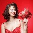Young woman with a red mysterious mask — Stock Photo #70001297