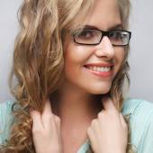 Friendly blond woman with glasses — Stock Photo