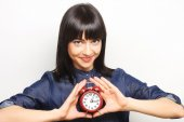 Young woman with alarmclock — Stock Photo