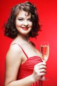 Woman in a red dress — Stock Photo