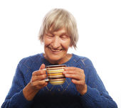 Happy old lady with coffee — Stock Photo