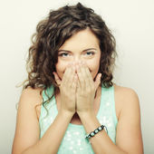 Beautiful young woman covering the face with her hand — Stock Photo