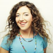Beautiful young surprised curly woman. — Stock Photo