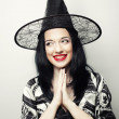 Funny Witch. Young happy woman with canival hat. — Stock Photo #70643101