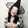 Funny Witch. Young happy woman with canival hat. — Stock Photo #70643117