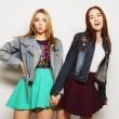 Two young girl friends standing together — Foto de Stock   #70748637