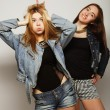Two young girl hipster friends standing together — Foto de Stock   #70748691