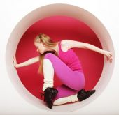 Sporty woman posing in pink circle — Stock Photo
