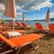 Sunchairs with  umbrellas on beautiful  beach — Stock Photo #71128819