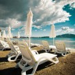 Sunchairs with  umbrellas on beautiful  beach — Stock Photo #71128833