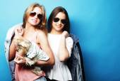 Two teenage sisters with Yorkshire Terrier — Stock Photo