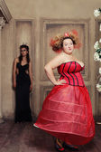 Two queens in carnaval dress. Black and red. — Stock Photo
