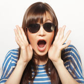 Young girl in sunglasses a look of surprise — Stock Photo