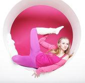 Sporty woman posing in pink circle — Foto Stock