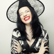 Funny Witch. Young happy woman with canival hat. — Stock Photo #72362713