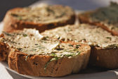 Bread with garlic butter — Stock Photo