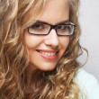 Friendly blond woman with glasses — Stock Photo #72632317