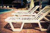 Beach chairs side swimming pool — Stock Photo