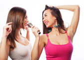 Sensual girls singing with microphone — Stock Photo