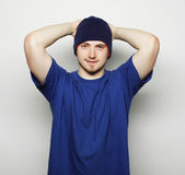 Man in blue t-shirt and blue hat. — Stock Photo