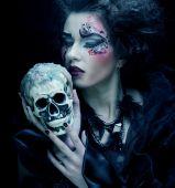Fantasy woman with skull. Halloween theme. — Stock Photo