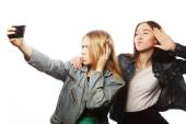Two smiling teenagers taking picture — Stock Photo
