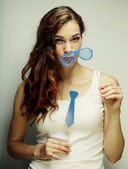 Playful young woman holding a party glasses. — Stock Photo