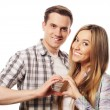 Happy couple showing heart with their fingers — Stock Photo #73338787