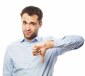Disappointed young business man with thumb down. — Stock Photo