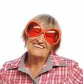 Senior happy woman wearing big sunglasses — Stock Photo
