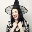 Funny Witch. Young happy woman with canival hat. — Stock Photo #73627149