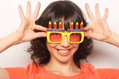 Young happy woman with big orange sunglasses — Stock Photo