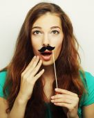 Girl wearing fake mustaches. Ready for party. — Stock Photo