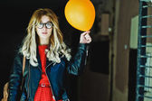Young hipster woman with balloon in the city — Stock Photo