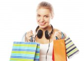 Young happy smiling woman with shopping bags — Stock Photo