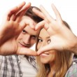 Happy couple in love showing heart — Stock Photo #74169237