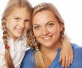 Mother and her daughter smiling at the came — Stock Photo