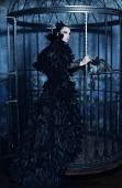 Fashion model in fantasy dress — Stock Photo