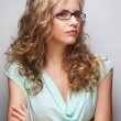 Friendly blond woman with glasses — Stock Photo #74358891