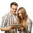 Happy young couple holding tablet pc computer — Stock Photo #74363431